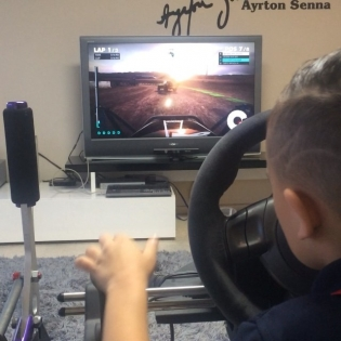 Teach em young, @lincoln_whiddett thrashing some trophy trucks on the simulator before school. This kid going to waste dad one day.