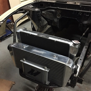@mishimoto rad, intercooler and oil cooler all mocked up ready to keep my @runbc 2jz cool. Radiator is huge so was a bit of a challenge to get in but fits good now. I tried to keep things as simple as possible and radiator and intercooler will lift in and out as one unit