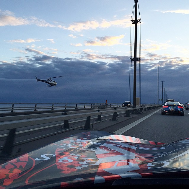 Caught this pic on the bridge from Sweden into Denmark with the @gumball3000 helicopter following us. Enjoying the scenery while my codriver @nataliepack is driving is also a super cool experience. | #dai9 #gumball3000 #viper #guess #rally #sweden #denmark #mdw #nataliepack #dai #rideordai