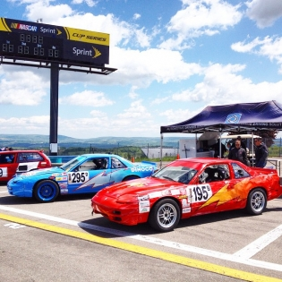 The 2-car S13 team. Blue car is 1UZ, red car is KA24. Wrinkles on the rear quarter were there before I drove, I swear.