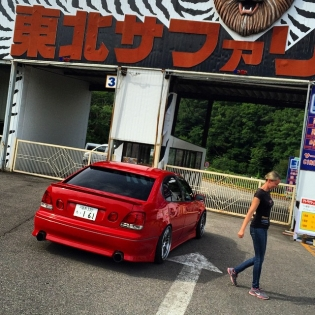 The real reason why I'm in Japan right now is that I've long been wanting to go on a training mission to start learning the black art of Japanese style drift chasing. Andy Gray and his wife Emily (in the picture) offers exactly that: Arrive & drive packages where you get your own practice missile car and learn from the best on 7 different course layouts. It's Disneyland for drift addicts! And being picked up in Emily's private Toyota Aristo and staying with these guys for a weekend... I don't think a training camp gets much cooler than this.