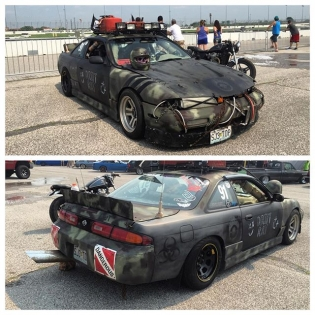 This 240SX is insane! And the best part is... He daily drives it too! License plate spoilers, camo netting, and chains to hold the bumpers on. Not something you see everyday...