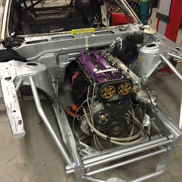 #dmac240 take two is coming along nicely. The @runbc 2jz with @jepistons it back in. We had to make new engine mounts as they were bent from the crash. Pedals are also in. The right had drive wiper motor is a very cosy fit #dmac #dmac240 #dmacspec #dmaccontrolarm #dmacsuspension #mcnsport #dmacbrakelines #dmacsteeringangle #dmacfuelcell #mishimoto #haltech #driveshaftshop #sunoco #samcosport #workwheels #wcpdyno #mcnsport #turbosmart #engineeredtowin #steerandsave #asnu #abcclutch #turbobygarrett #turbolife #jepistons #helperformance #obp #gripfab #runbc #dansbodyworx@mishimoto @haltechecu @turbobygarrett @steerandsave @driveshaftshop @samcosport @helperformance @runbc @turbosmarthq @jepistons
