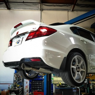 our final prototype GReddy cat-back exhaust for the late-model #Si. Photo shown with 2dr to 4dr adapter. More info on this coming soon...