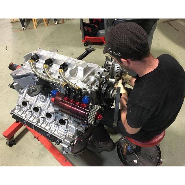Every year I post this photo and it still looks awesome. @bwillkillperson assembling our dry sump oil system on the VK56. This is essential for turning 9,000+ RPM!
