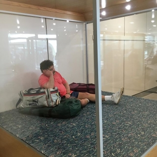 I just arrived Orlando to be greeted by a man sleeping in a glass box. This guy has been here for at least 5 years. Anyone else seen this guy before?- VGJ #heswaxedout #stuckinaglassboxofemotions