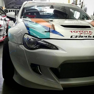 @daleyvisual finishing up the re-wrap on @kengushi's @greddyracing #NexenRacing #SRbyToyota 86. See the completed car with the new @rocket.bunny.pandem V3 kit in the @nexentireusa #SEMAshow booth and find the rest of the GReddy Team in the GReddy booth # 20671 in the Central Hall next week!