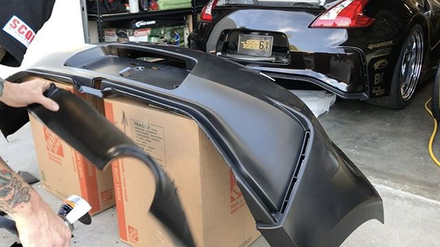 Prepping @nismo bumpers for my 370Z's with @boysjv. We trim the lower portion that covers the factory muffler to be lighter weight, more smoke flow, and it looks cooler too! These urethane bumpers can handle so much more abuse than your standard fiberglass piece.