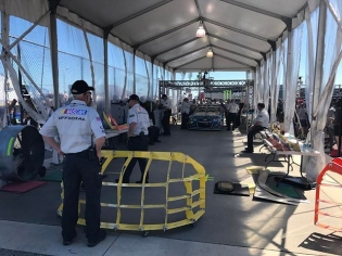 Team @valvoline driver and 7 time @nascar champion @jimmiejohnson and rolling through tech. Every car must pass through tech and they mount these prefabricated cages to check that they fit within the legal limits of aerodynamics. #teamvalvoline