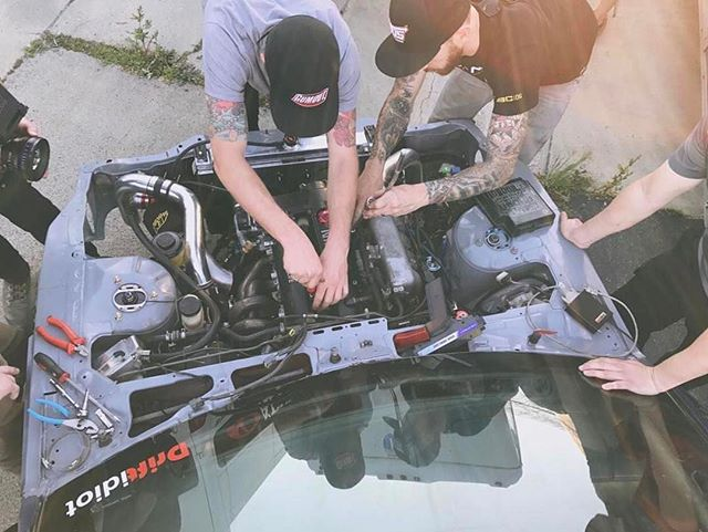 All hands on deck before getting @driftidiot's S14 on the Dyno. We were off a tooth on the timing chain so we sorted it quickly before handing it off to @racetune for a tune job. Season 4 is going to be pretty sweet. Been a long ass 8 days of endless hours filming and we aren't done yet. Stay tuned to @networka as these episodes start airing in April. @valvoline @donutmedia. 📸 @donutmedia