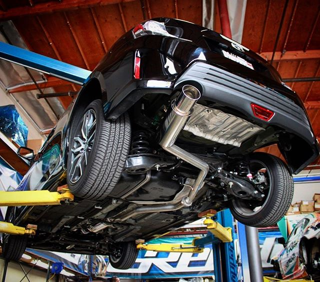 "Back in stock... full exhaust for the  The Revolution RS for the second generation Scion tC features large diameter 2.5"" mandrel-bent piping which extends all the way to the front of the vehicle's main catalytic-converter for maximum flow. Dyno testing shows gains throughout the usable power band, 9hp/6ft-lbs . The aggressively angled compact Revolution RS muffler is aided by an extra-large oval front resonator to help control sound quality. Like all GReddy Revolution RS systems, the exhaust is made from fully hand-welded 304 Stainless-Steel and carries a Limited Lifetime Warranty."