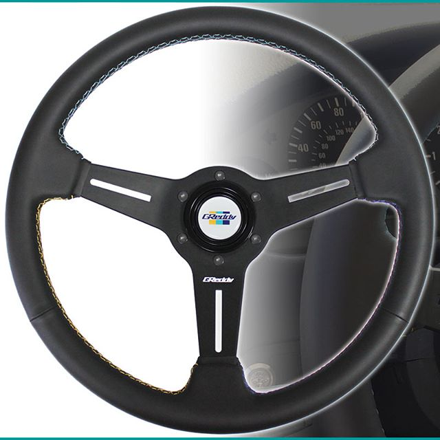 New GReddy - GPP Steering wheel with the special double cross stitching in Yellow, Teal and Navy-blue, arrives later this month.  Authorized GReddy Dealers and #ShopGReddy.com are now accepting pre-orders.  P/N 16500201  MSRP $260. Color : Black Shape : Round Material : Black Leather Stitching : Overlapping Cross Lock Stitching Color : Contrasting Yellow, Teal, & Navy Diameter : 340mm Dish (depth front to back) : 47mm (Med.) Spoke : 3 spoke, Black Anodized Grip : Ergo. 27-30mm (with shallow finger groves on the back side) Etching : GReddy logo center spoke Horn Button : White with Classic GReddy 3-Stripe logo