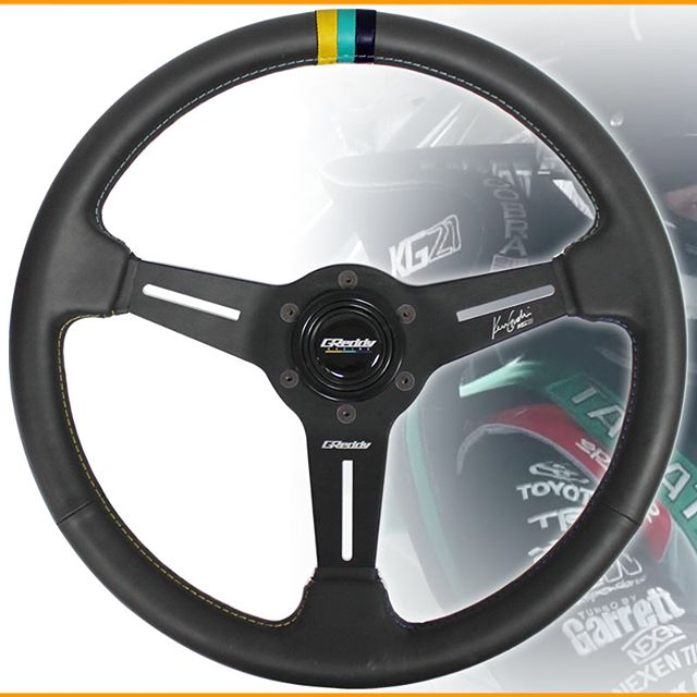 Now accepting Pre-order for the new X Ken Gushi Steering Wheels… arriving later the is month. Contact your favorite authorized GReddy Dealer or see GReddy.com for more details.  P/N 16500202 MSRP $260.  Color :  Black  Shape :  Round  Material :  Black Leather w/ Yellow, Teal & Navy Centering Stripe  Stitching :  Double Needle  Stitching Color :  Contrasting Yellow, Teal, & Navy  Diameter :  340mm  Dish (depth front to back) :  47mm (Med.) Spoke :  3 spoke, Black Anodized  Grip :  Ergo. 27-30mm (with shallow finger groves on the back side)  Etching :  GReddy logo center spoke / Ken Gushi autograph right spoke  Horn Button :  Black with GReddy Racing logo