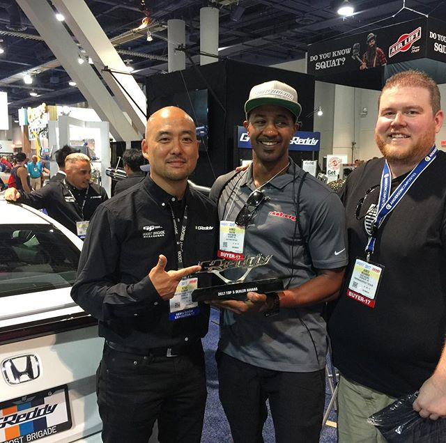 2017 Top 5 Authorized GReddy Dealer, @vividracing with their GReddy Award in the GReddy booth