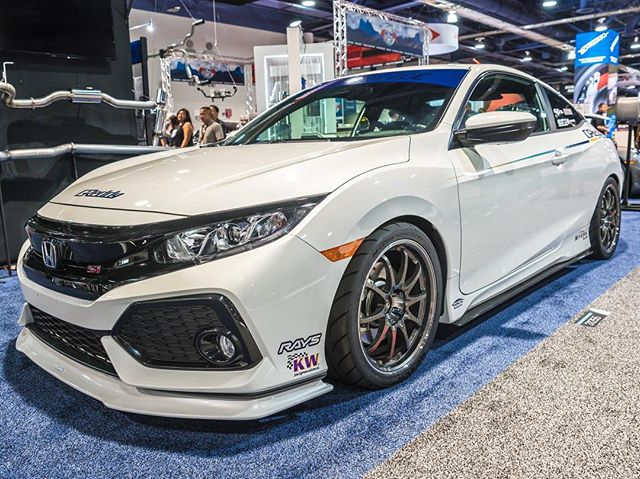 GReddy Performance Products Civic Si with front lip spoiler, Intercooler, Oil Cooler, Supreme SP exhaust and Sirius Vision Meter.  booth 31255. Upper South Hall