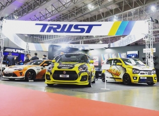 Coming up on the third and final day the 2018 @tokyo_autosalon @TRUST.GReddy booth. Let's take another quick look at the #GReddy cars in the booth. GReddy #Kouki86, GReddy #SwiftSport, GReddy #AltoWorks, GReddy Twin T88-38GK #NissanPatrol and GReddy #R34 #GTR