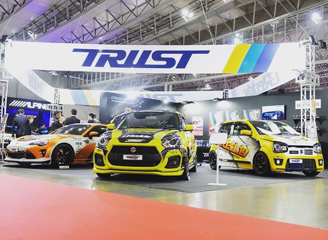 Coming up on the third and final day the 2018 @tokyo_autosalon @TRUST.GReddy booth.  Let's take another quick look at the cars in the booth.  GReddy #Kouki86, GReddy #SwiftSport, GReddy #AltoWorks, GReddy Twin T88-38GK and GReddy