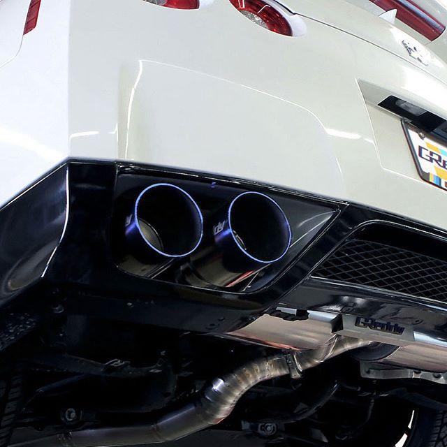 "GReddy Y-Back Exhaust for the 50% weight savings.  In stcck, contact your favorite Authorized GReddy Dealer for more… GReddy p/n 10128294  The ideal exhaust for the R35 GT-R is the 94mm GReddy Supreme TI. The design provides great performance for upgraded GT-Rs but still comfortable for milder, daily-driven GT-Rs. The large dual oval mufflers provide excellent sound suppression and sound quality, while large piping frees up power for the twin turbo VR engine. This version comes with a huge dual 80mm (3.15"") to 94mm (3.7"") Y-pipe. The construction is made up of carefully hand-built 94mm piping is pain-painstakingly ""inch-welded"" for excellent fitment and flow. Revised larger 125mm quad staggered Tips complete each 94mm R35 GReddy Supreme Ti system."