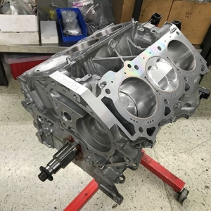 This year @amsperformance is building their first ALPHA VQ engine for my FD program. This reinforced closed deck block from @rjmanufacturing is stuffed with a @runbc 4.0L stroker kit, high compression @jepistons, and @arpbolts holding it all together! #turnitup #1000hp