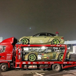 Spotted @daigosaito87's toys leaving the @fia_drifting_cup over the weekend. @hgkracing Eurofighter, HGK-bodied C6 Corvette on a stacker flatbed with a pile of tires. Not a bad setup for track days, ehhhh? #gimme #doingitright #eurofighter #corvette #drifting #