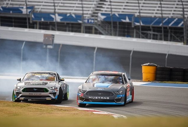 Formula Drift Champ @vaughngittinjr welcomes NASCAR Champ @joeylogano to the Iconic @fordperformance Mustang Family by drifting around @charlottemotorspeedway! Video on our Facebook Page! #FormulaDRIFT #FormulaD